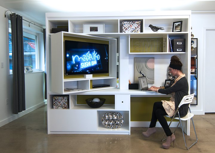 TV stand revolves to reveal bookcase